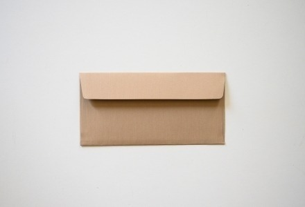 A brown envelope on white background