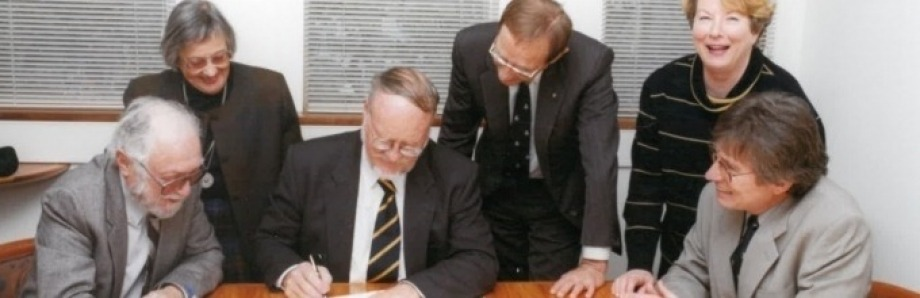 Dr Herbert Freilich, Mrs Valmae Freilich, Professor Deane Terrell, Vice Chancellor of the University, Professor Peter Baume, Chancellor of the University, Ms Maureen McInroy, Acting University Secretary, Professor Iain McCalman, at the signing of the Foundation Charter, July 1999.